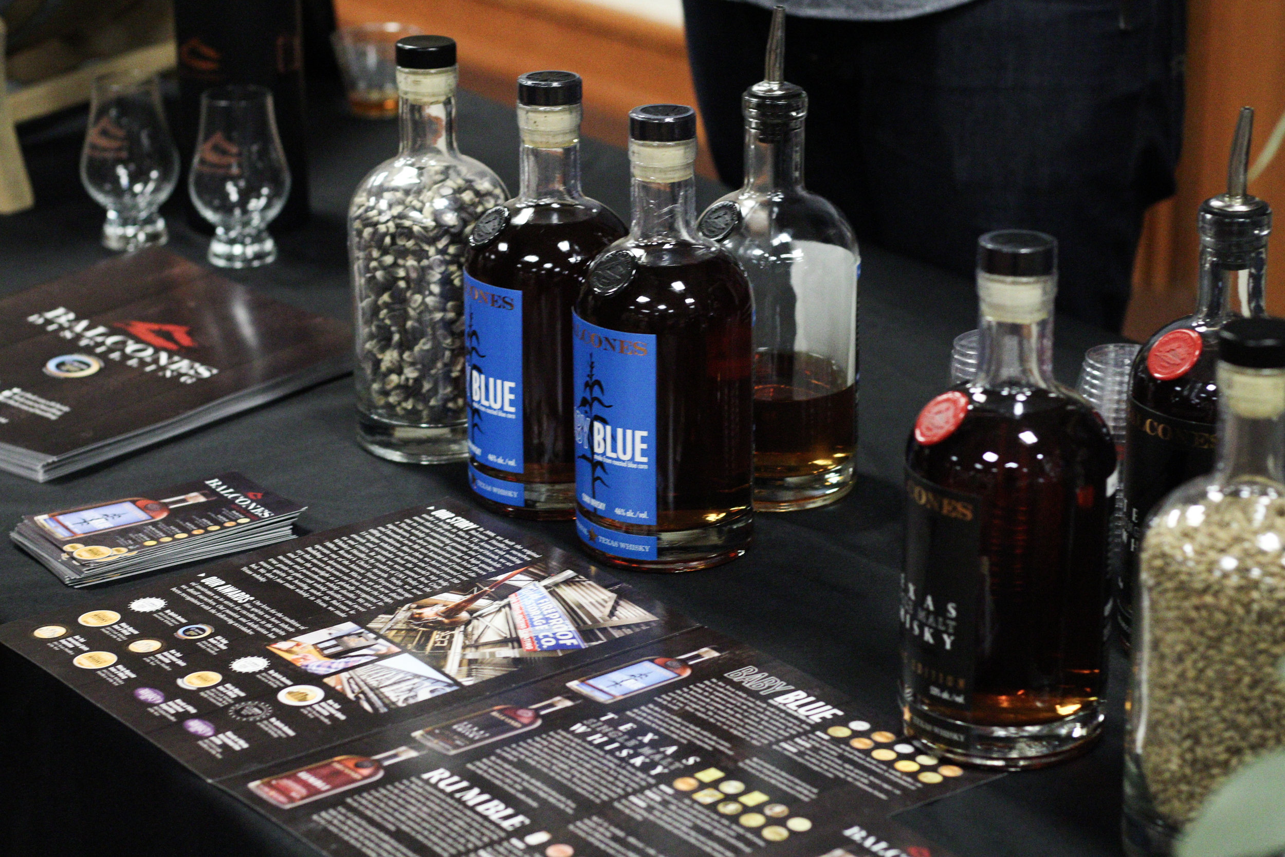 Balcones Distillery provides samplings of its whiskey products to exhibition guests.