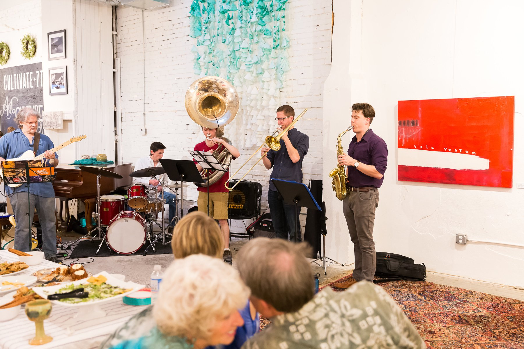 Chuck Jennings (far left) plays alongside other local artist at Cultivate 7twelve's monthly jam sessions.  (photo by Cultivate 7twelve)