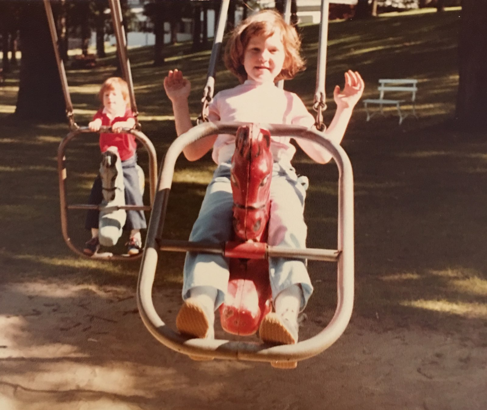 My sister and I on swings near the hotel.