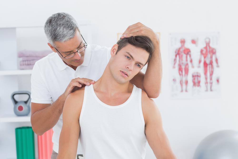bigstock-Doctor-doing-neck-adjustment-i-85571075.jpg
