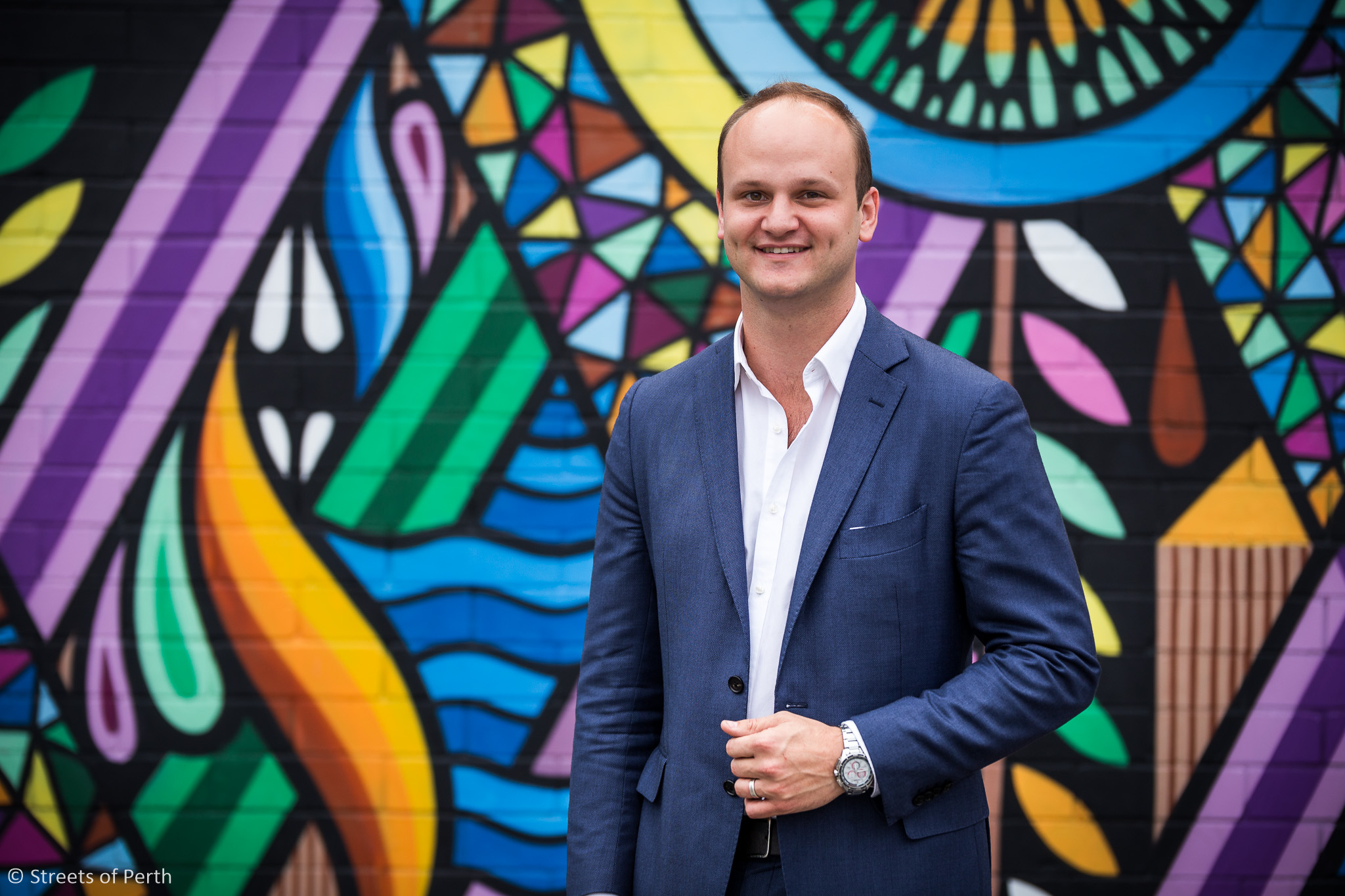 Perth Lord Mayoral candidate Reece Harley is a keen supporter of public art projects like this mural by Beastman and Vans the Omega in the open air car park on Murray St in the city.