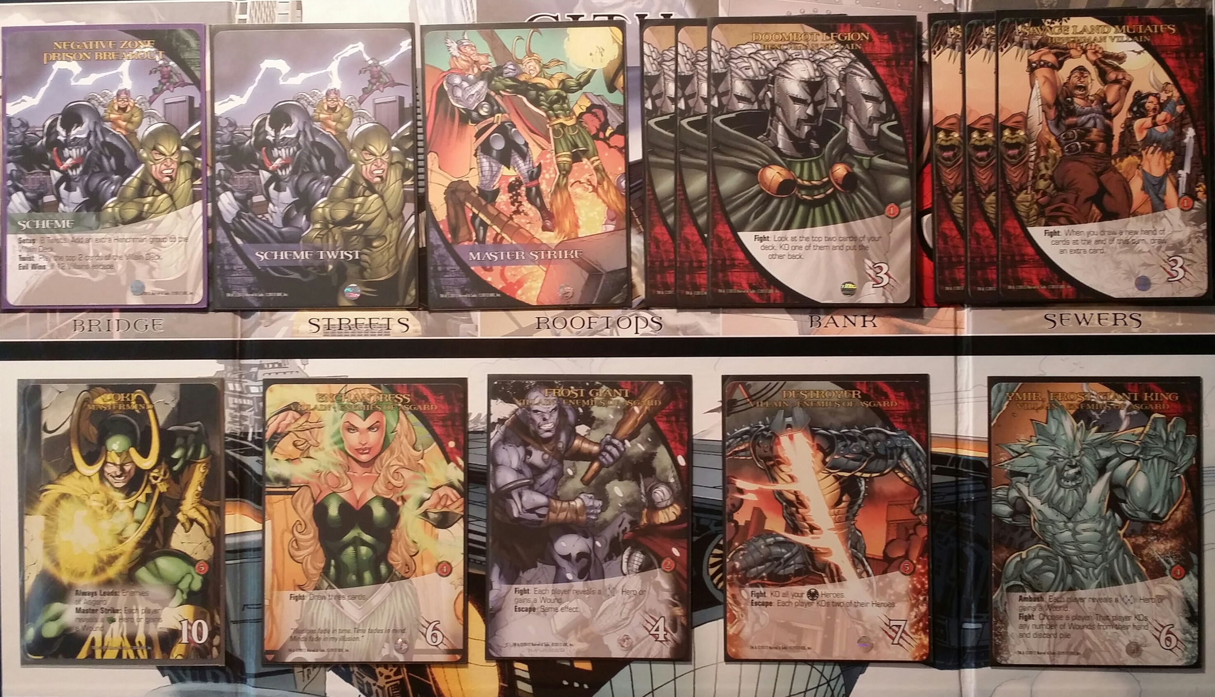 In this example with 4 players, the Mastermind Loki, and the Negative Zone Prison Breakout Scheme the breakdown is: 3 Villain Groups (1 having to be the Enemies of Asgard Villain Group as dictated by Loki and 2 others of choice)/2 Henchmen Groups (Doombot Legion and Savage Land Mutants)/8 Bystanders/8 Scheme Twists (dictated by the chosen Scheme)/5 Master Strike cards are all shuffled together to form the Villain Deck.  The Heroes Wolverine/Hulk/Iron Man/Storm/Spider-Man are all shuffled together to form the Hero Deck.