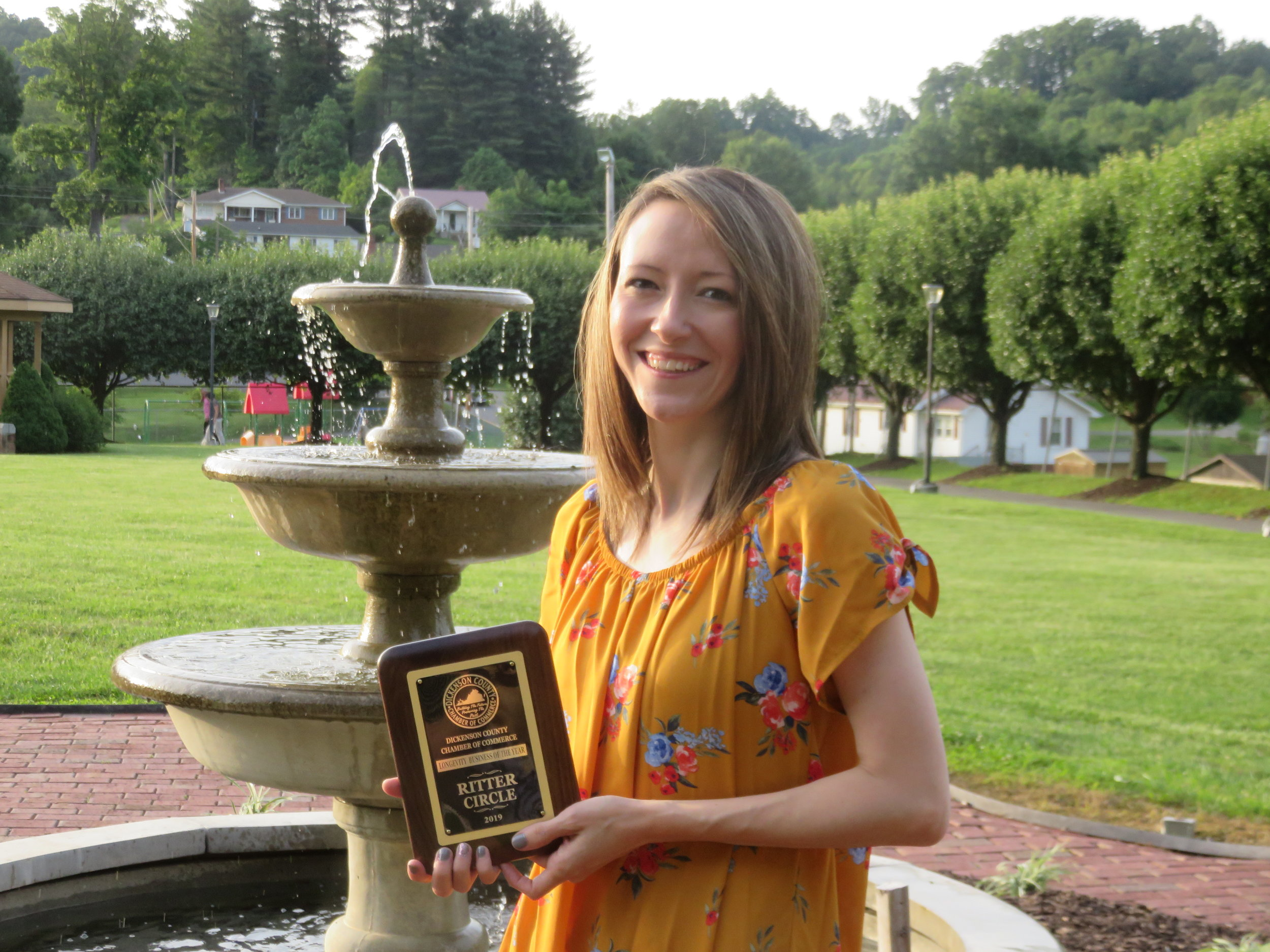 Brittany Bise accepting award for Ritter Circle, Inc.