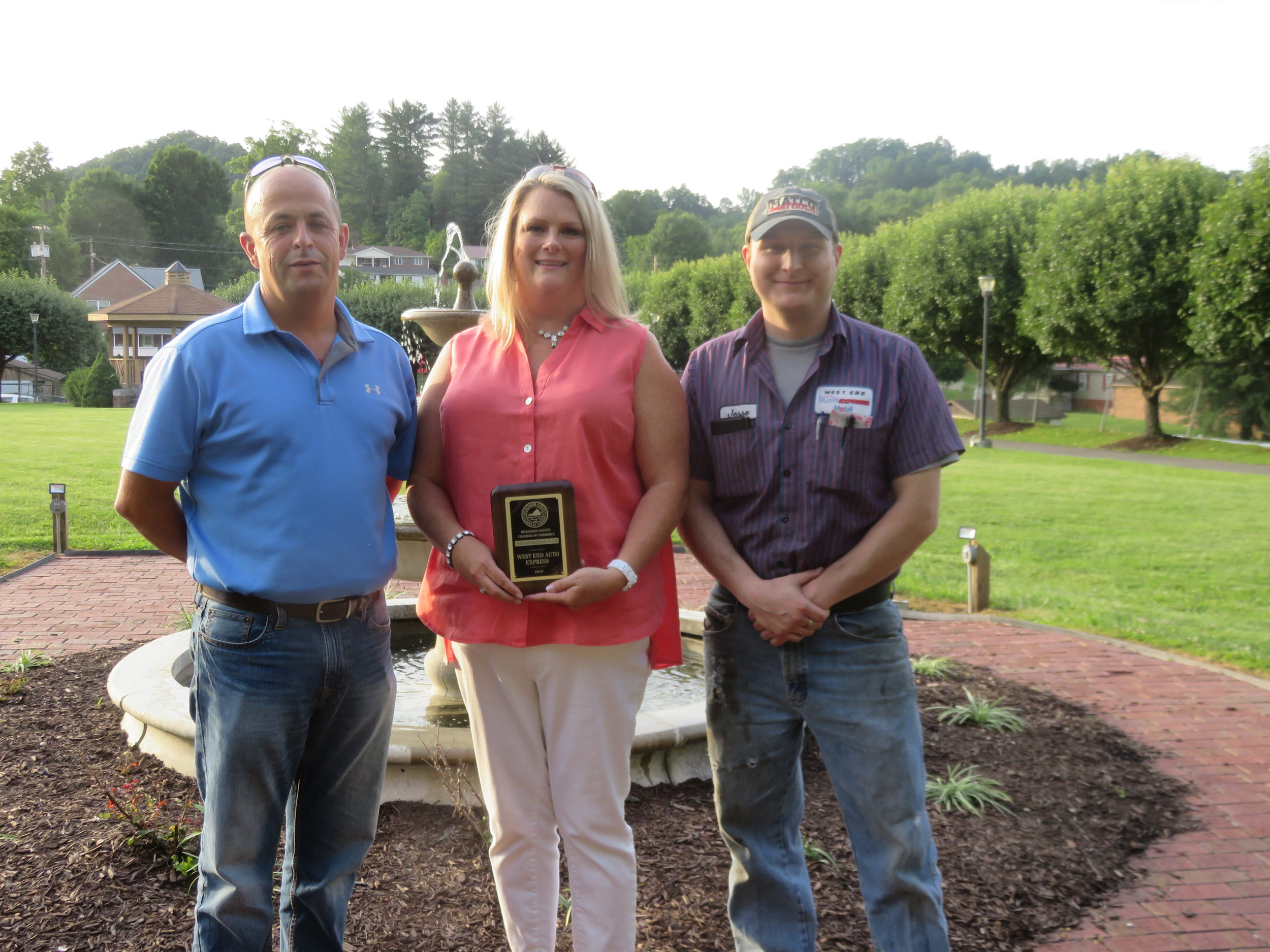 Shelly & Jennifer Mullins and Jesse Crihfield accepting award for West End Auto