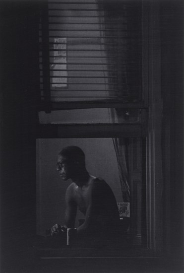 - Roy DeCarava (1919-2009) Man in window, New York, 1978