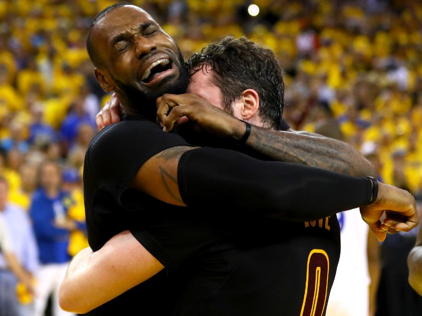 "LeBron gives Kevin Love a huge hug after the win. ""Thanks man for letting me convince you to be on my team."""