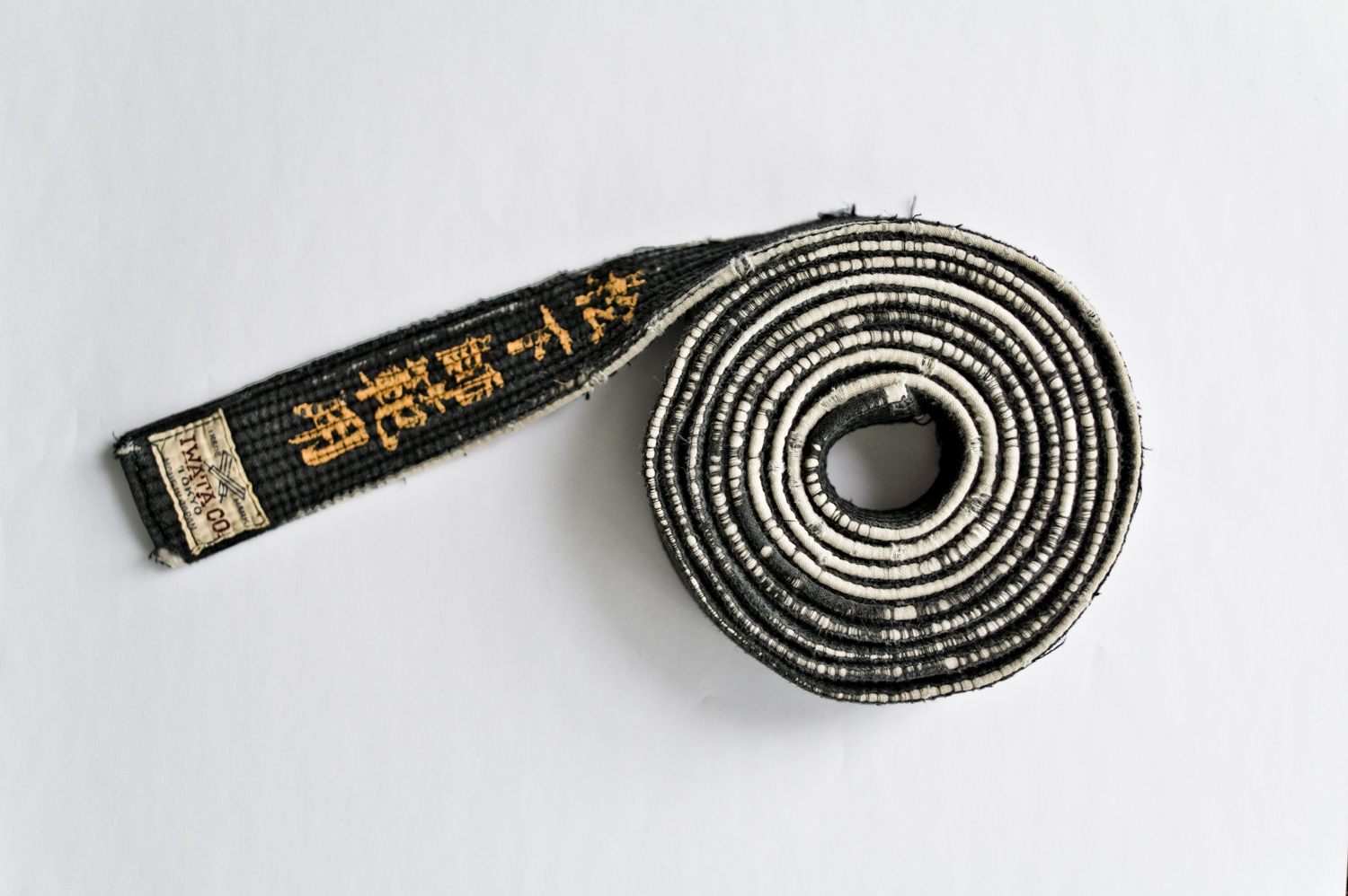 Akinori Hosaka's belt, and name in Japanese.  When he came to England he was a true contest 5th Dan Judoka.