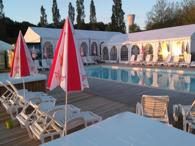 The campsite boasts an outdoor pool area with 'cuddle corners' around it