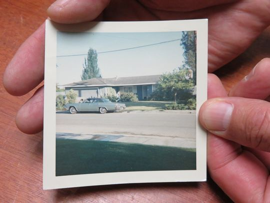 """Dave Reddix holds a picture of the """"Waldomobile,"""" a 1966 Chevy Impala that he and his friends used to get stoned in before searching for an elusive patch of pot.(Photo: Photo by Jenny Kane/RGJ)"""