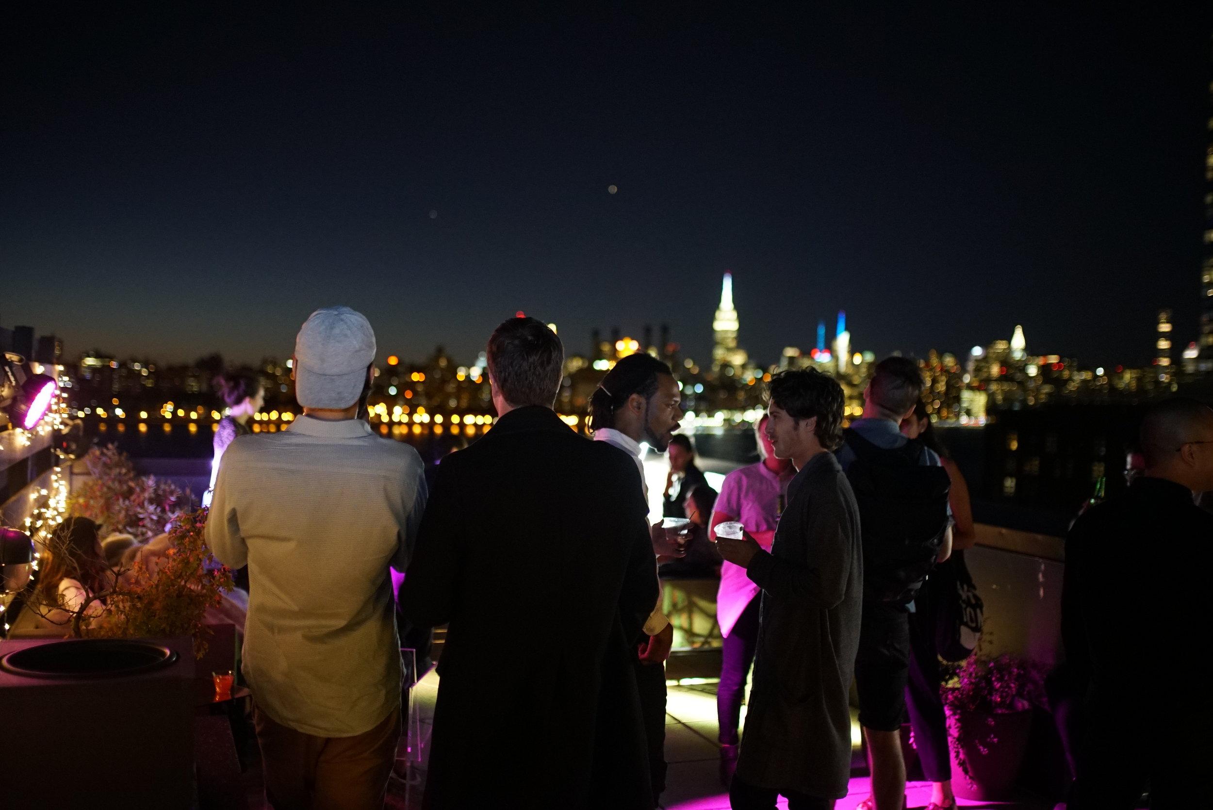 Guests enjoying rooftop views.