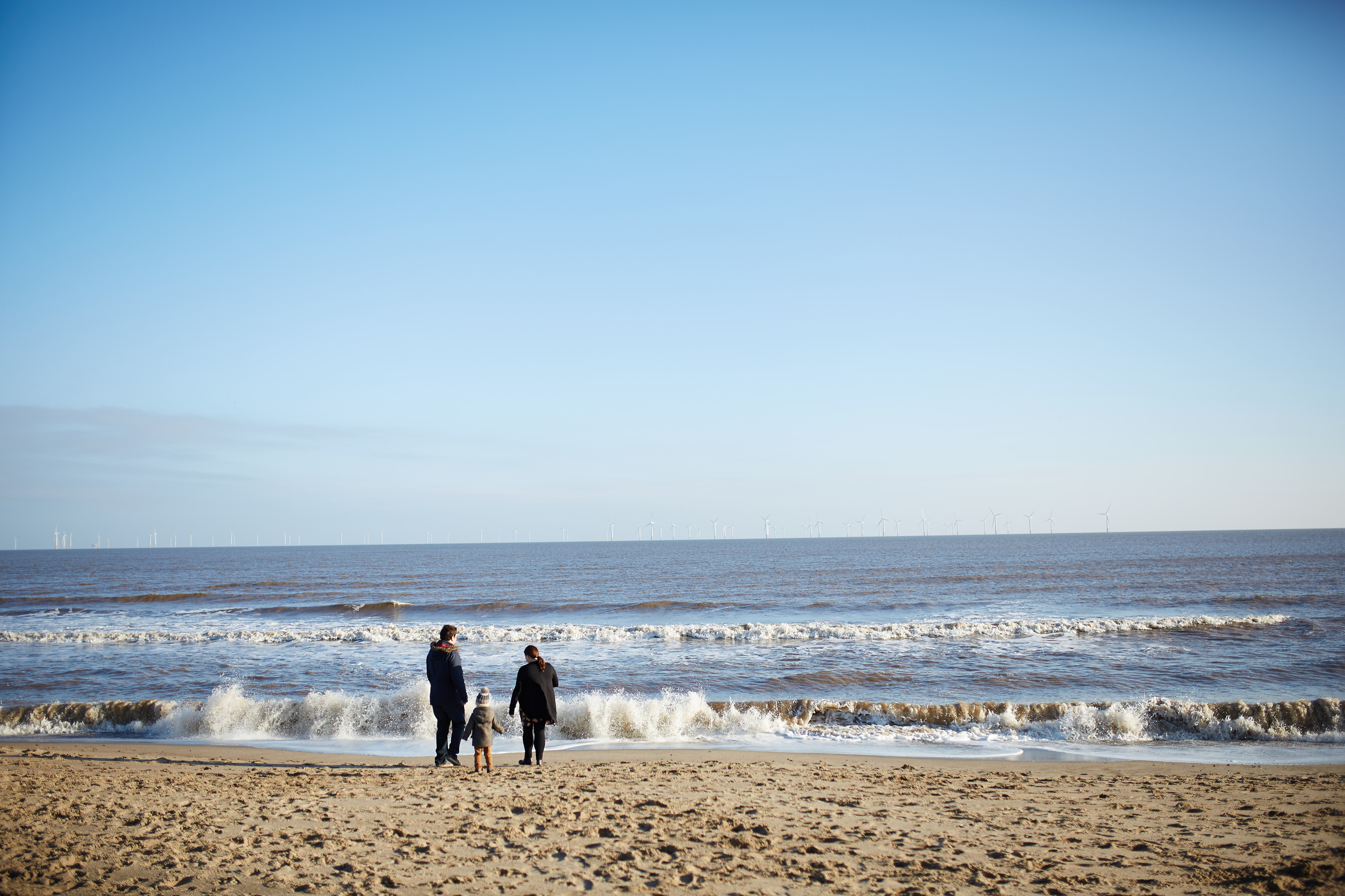A family by the sea shore in Skegness