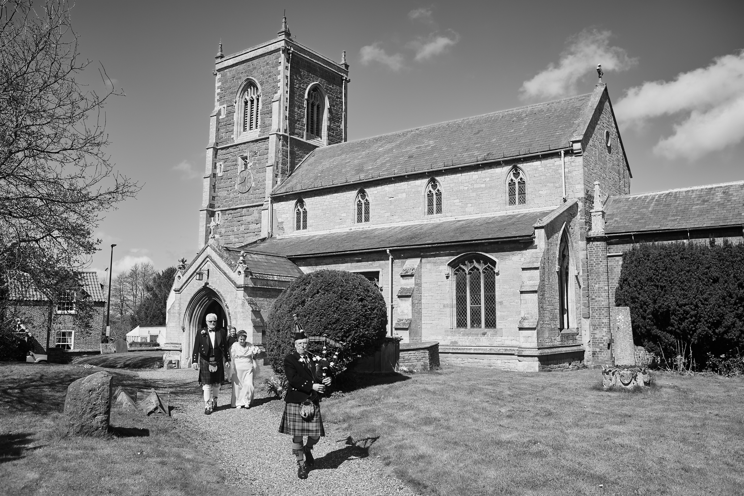 The newly married couple leave church on their beautiful wedding day in Partney, Lincolnshire.