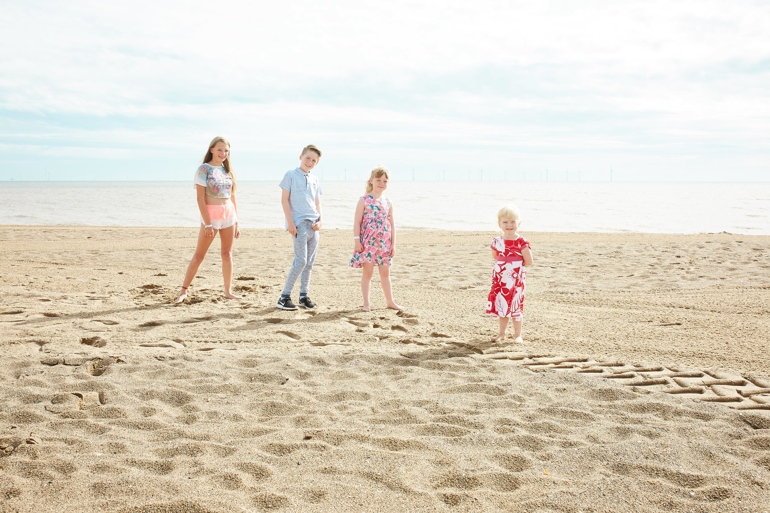 A family portrait at Skegness beach by Lincolnshire wedding photographer 166 photography