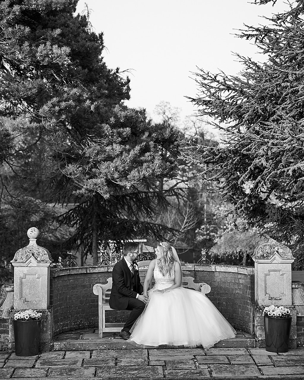 A wedding at Kenwick Park Hotel Louth,. The bride & groom sit in the grounds.