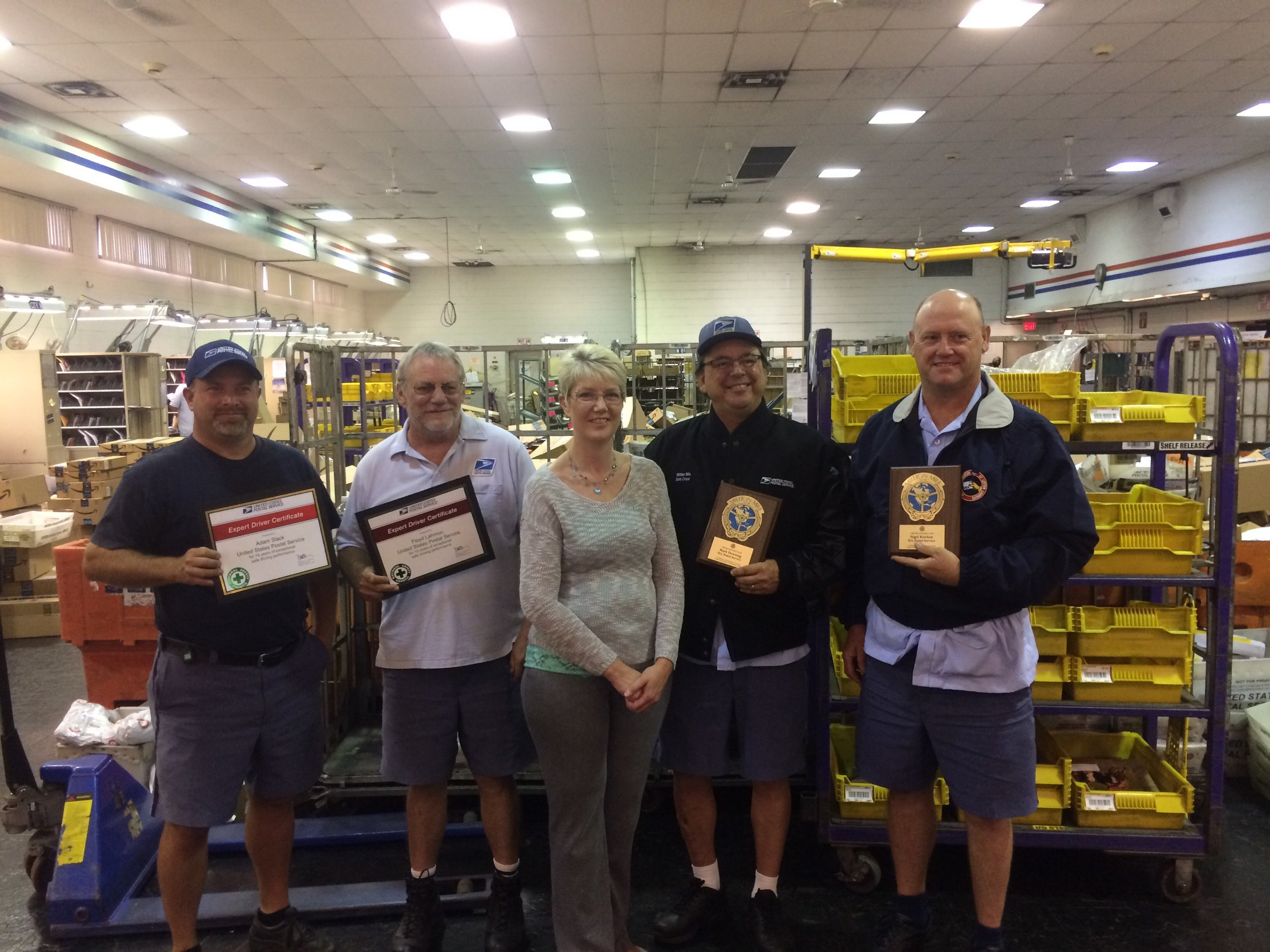 L to R: Adam Slack (18 yr safe driver), Floyd Lahmon (18 yr safe driver) , Melisa Simmons postmaster, Mark Downing & Dave Kitchen million mile award.