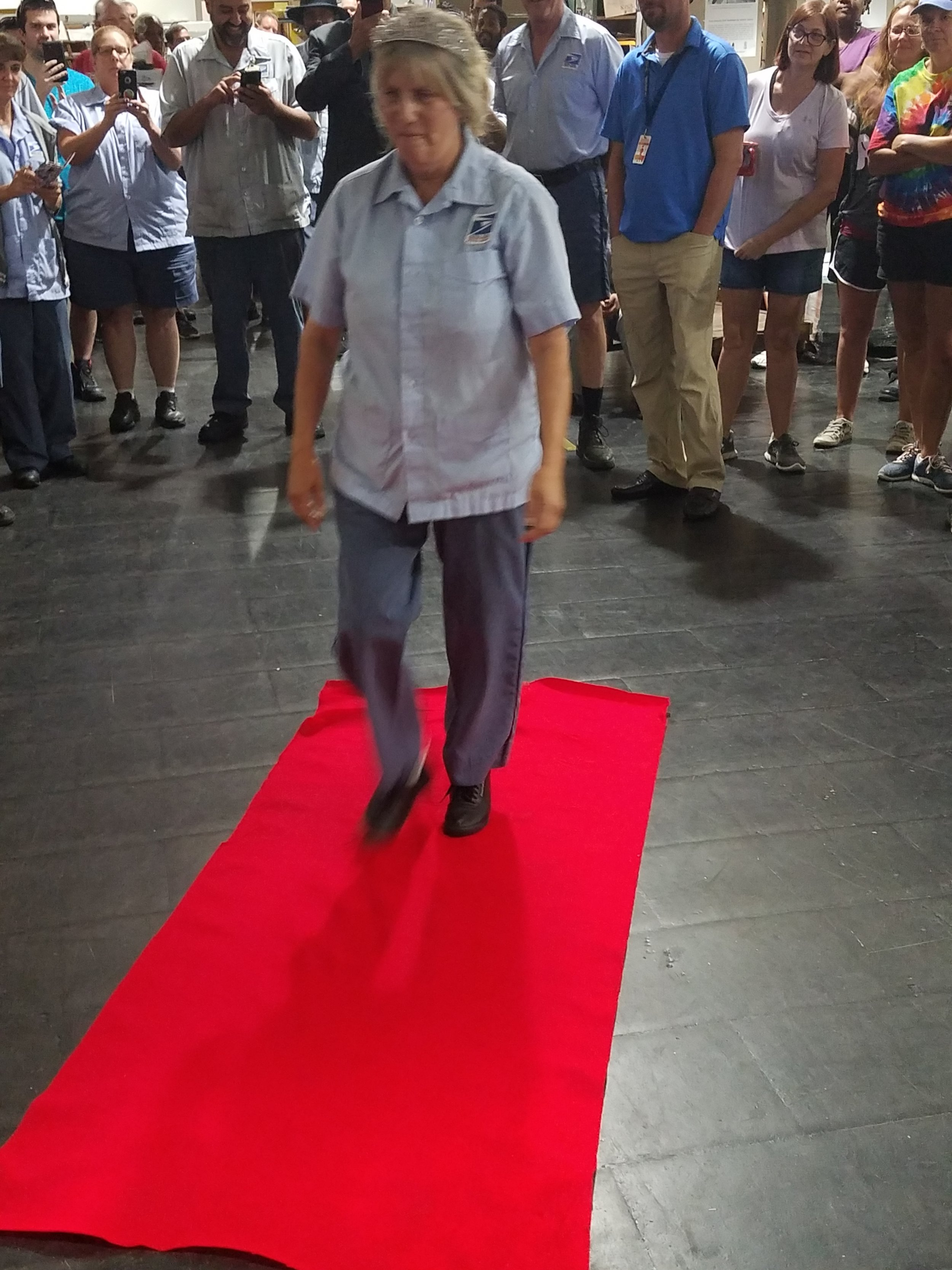 Marcy walks the red carpet to retirement