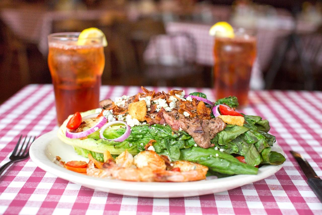 Our Father's Day Salad with steak and grilled shrimp on a romaine salad wedge.