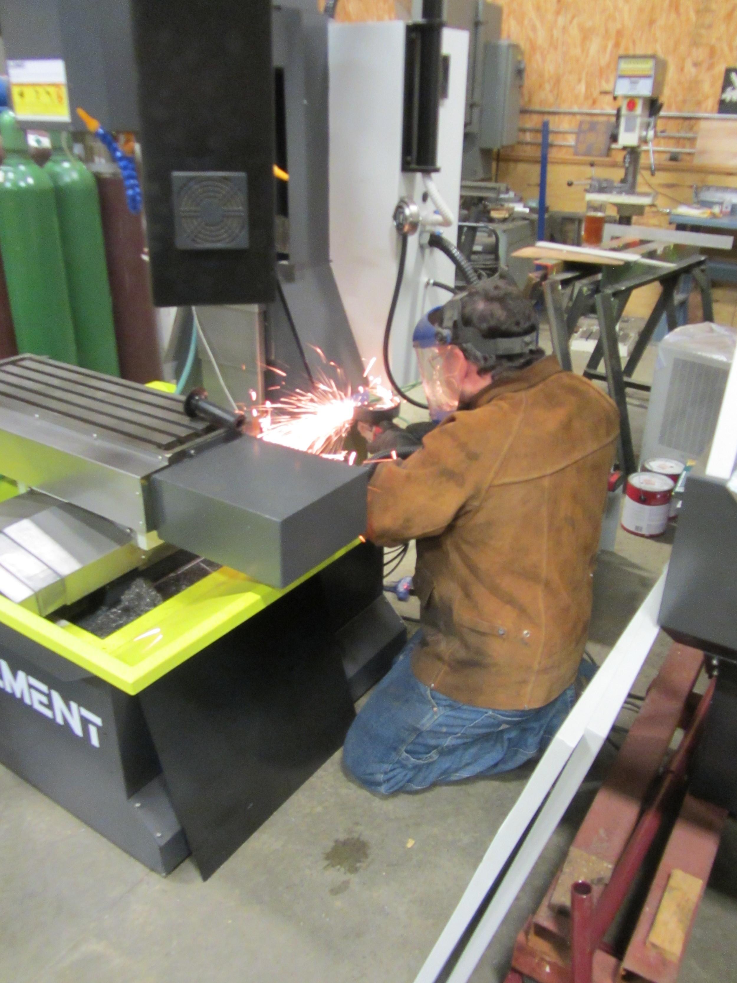 Modifying sheet metal for the conversion.