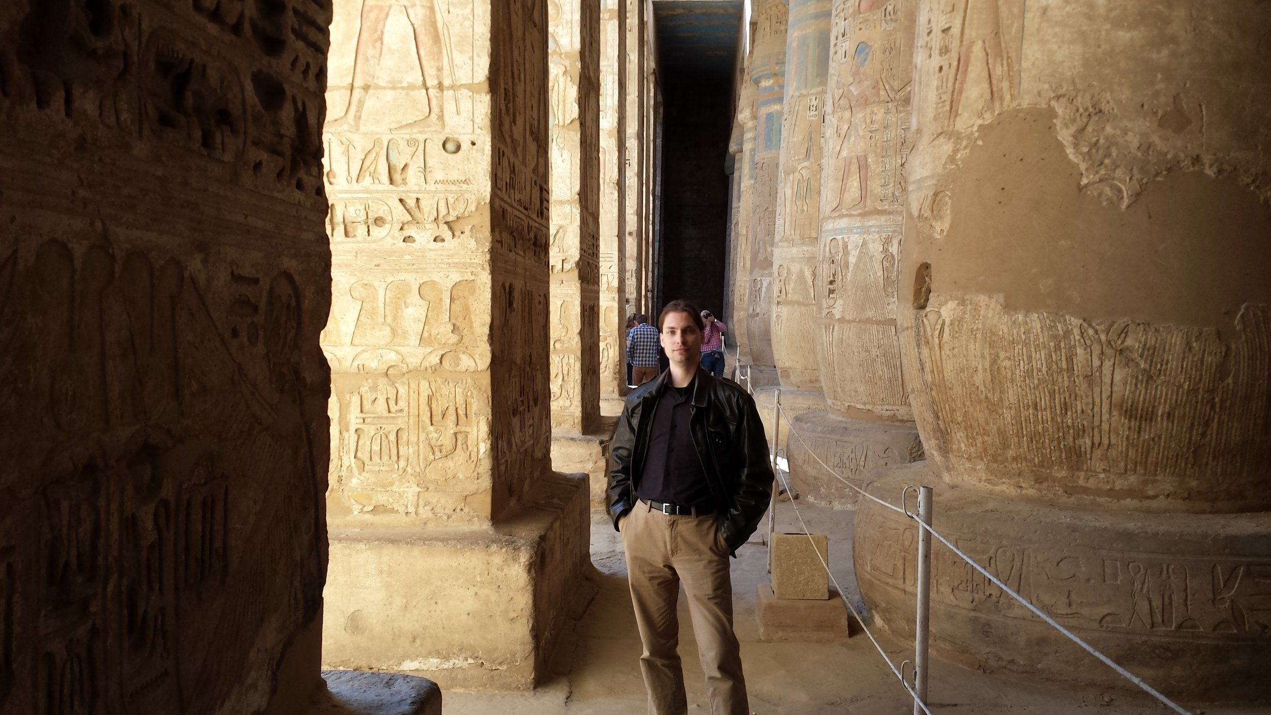 Some fool posing among the columns of the temple. You can still see some color on a few.