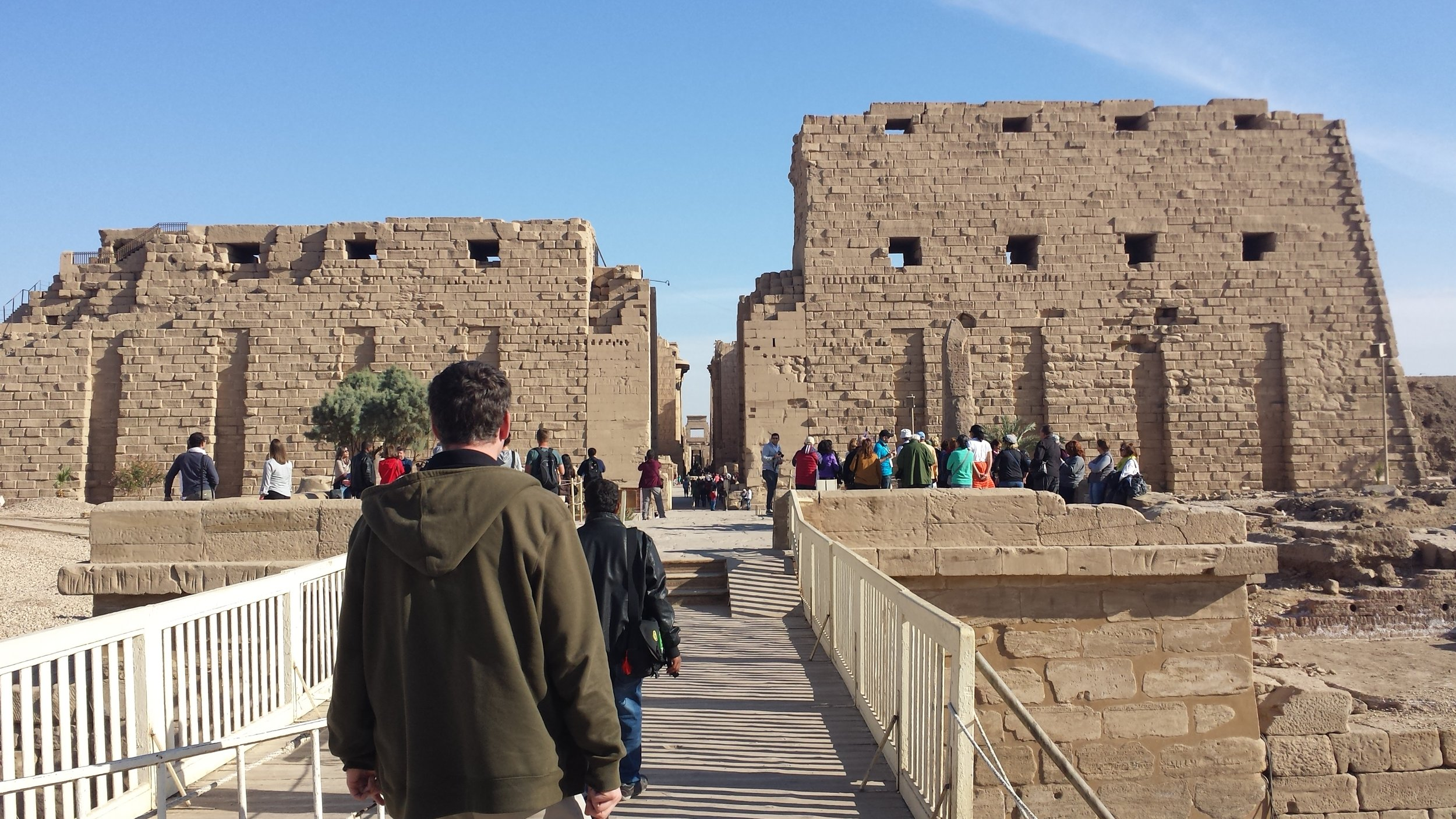 Dan and our guide approaching the entry to the Karnak temple complex and its unfinished pylons.