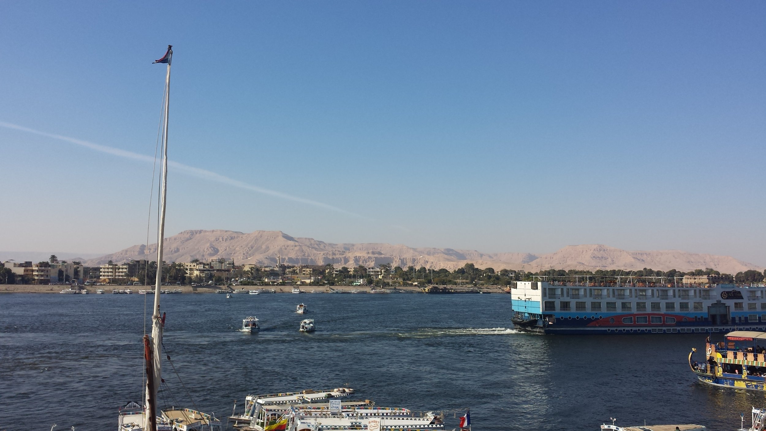 A view of Luxor's west bank from across the Nile. Those hills are where all the tombs are.