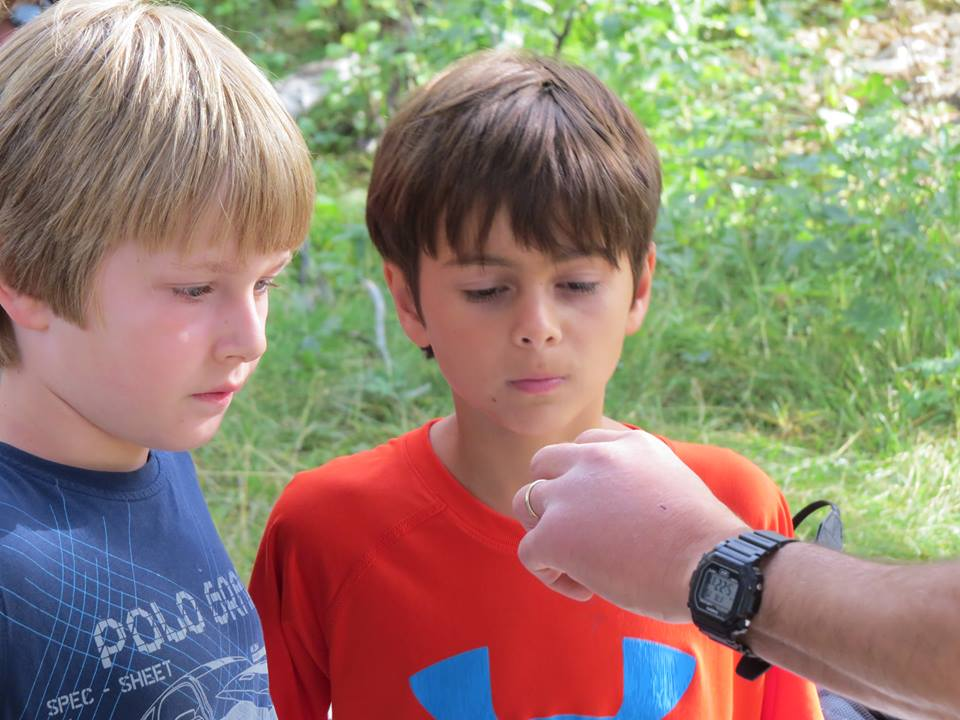 Showing some young birders a hummingbird up close.