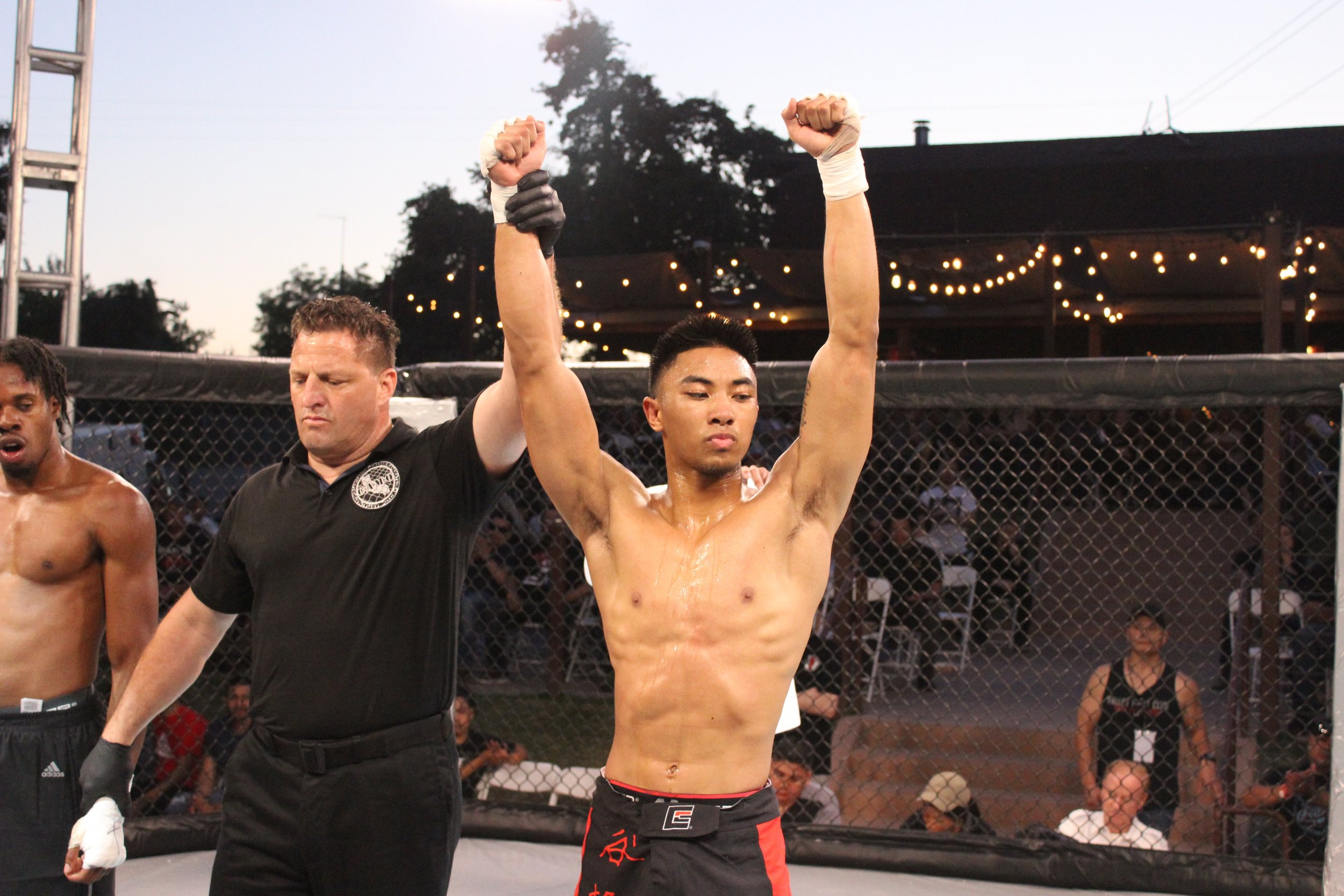 Denzel Rosaroso has his hand raised in victory following a dominant unanimous decision win.
