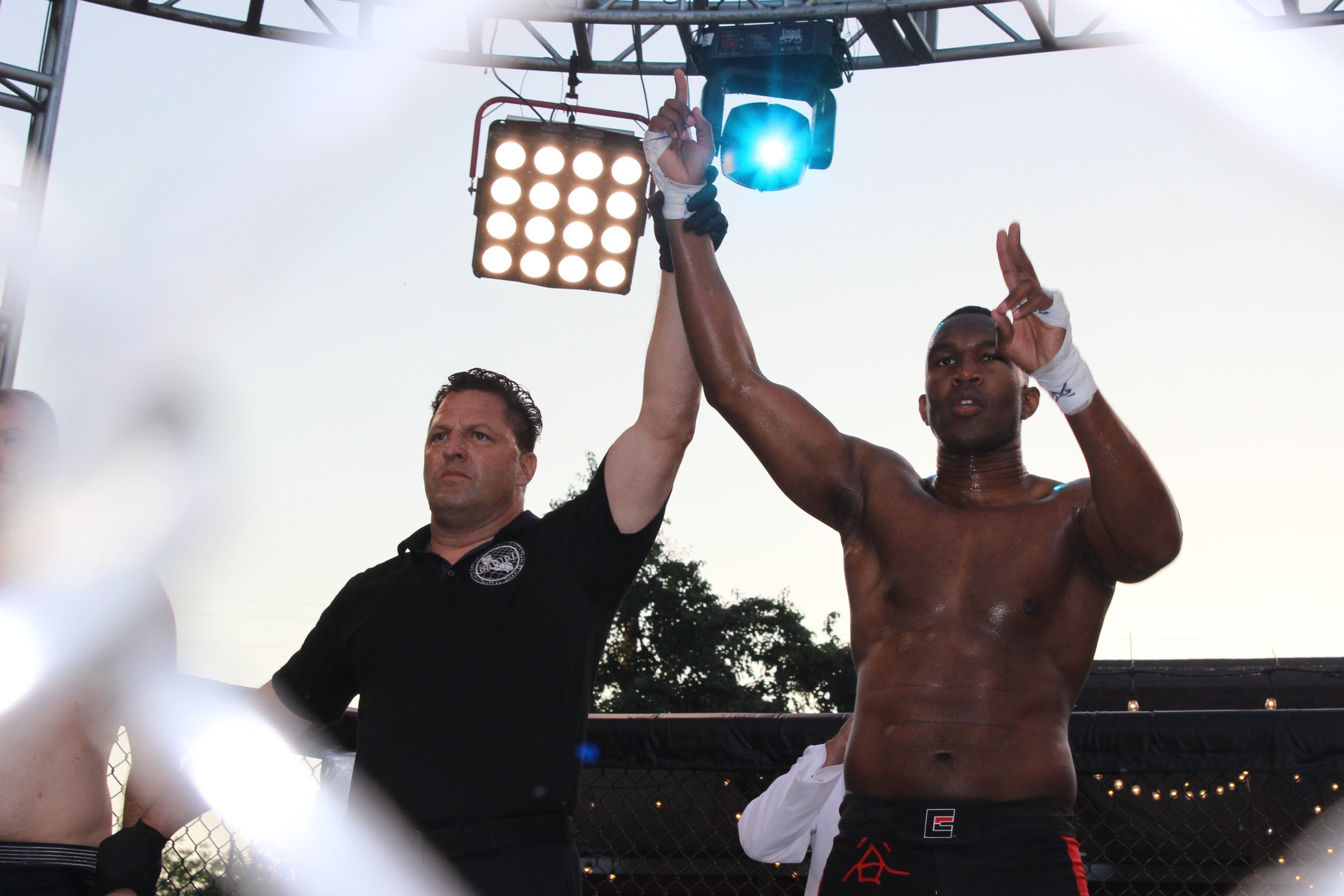 Marqus Blevins has his hand raised in victory following a first-round TKO win.