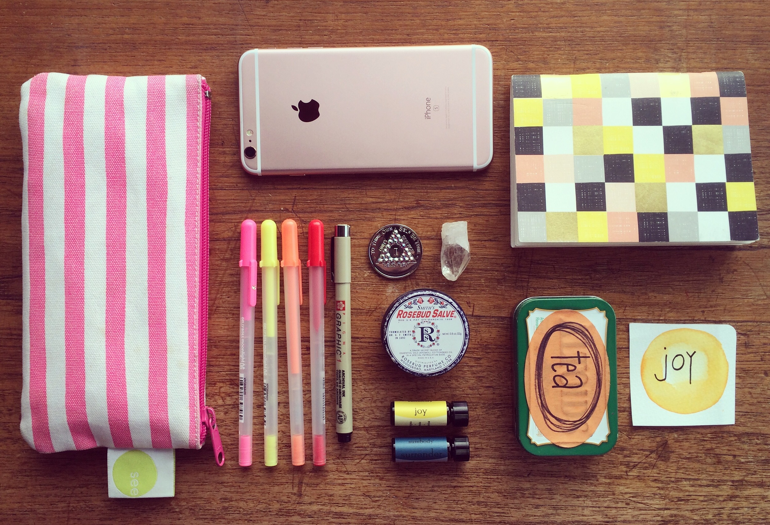My Sobriety Toolbox :: pens, phone, 1 year sobriety chip, crystal, lip balm, essential oils, tea bags, mantra card + notebook