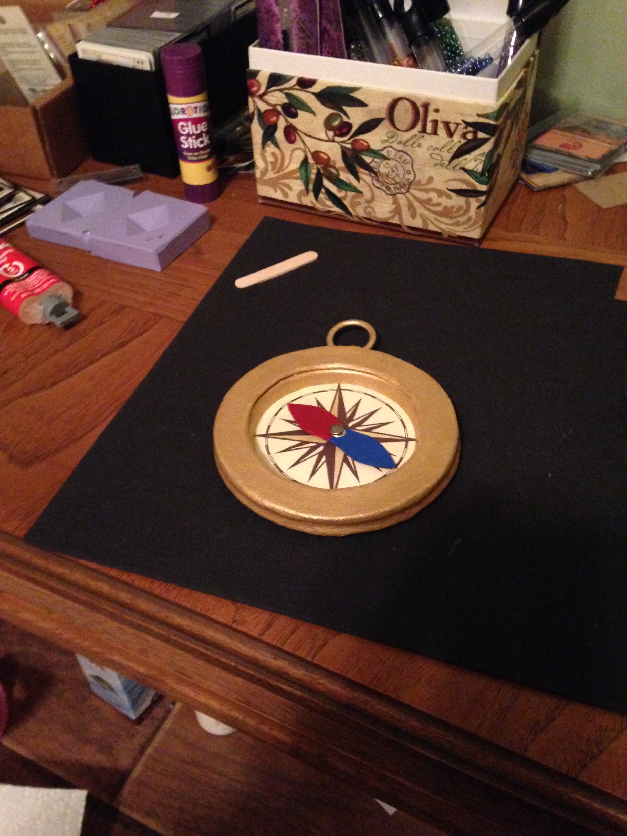 The compass is totally done minus the gold chord that it hangs from. And the thing in the middle actually spins!!