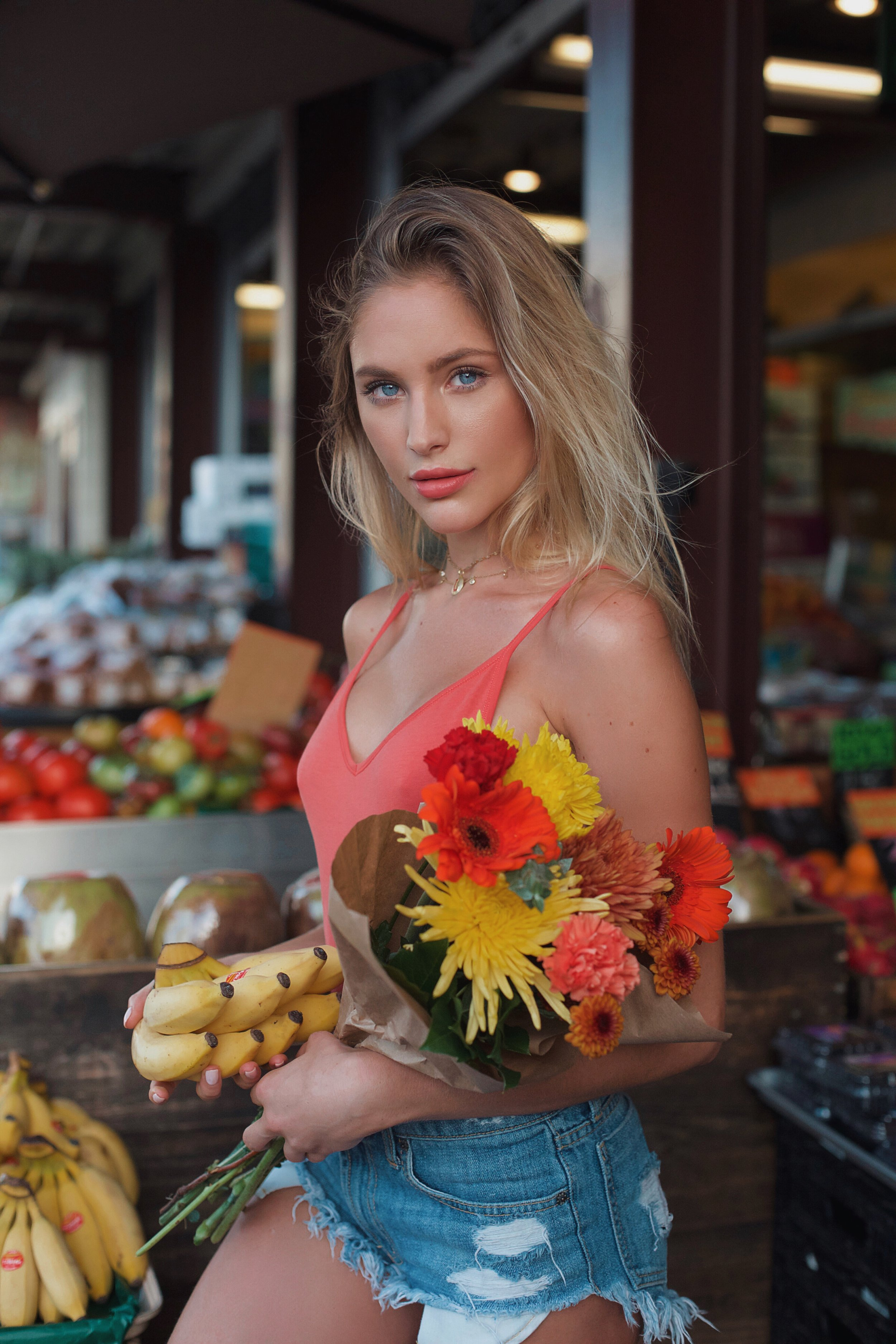 Farmers Market holding flowers.JPG