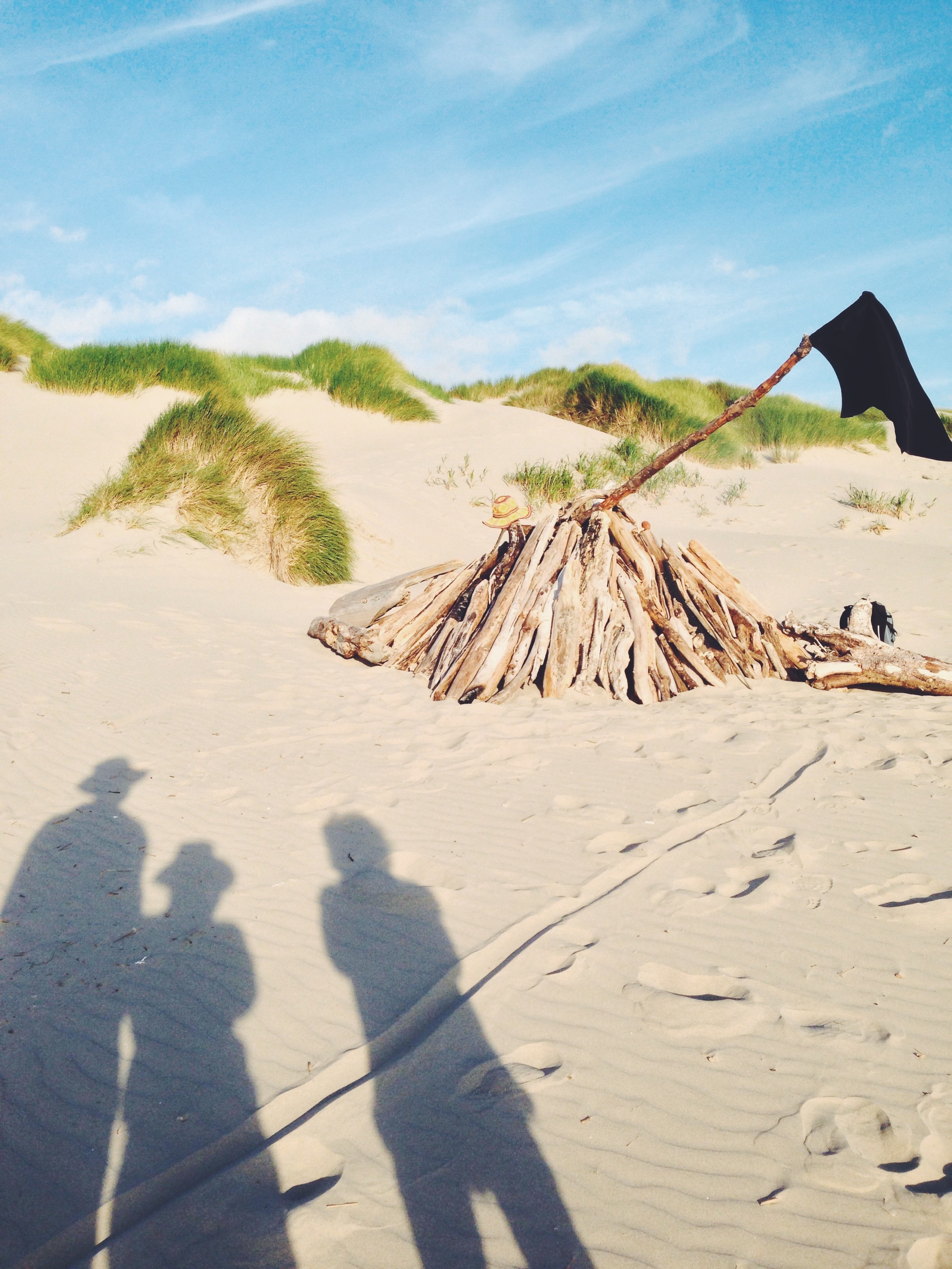 Inspecting our driftwood fort
