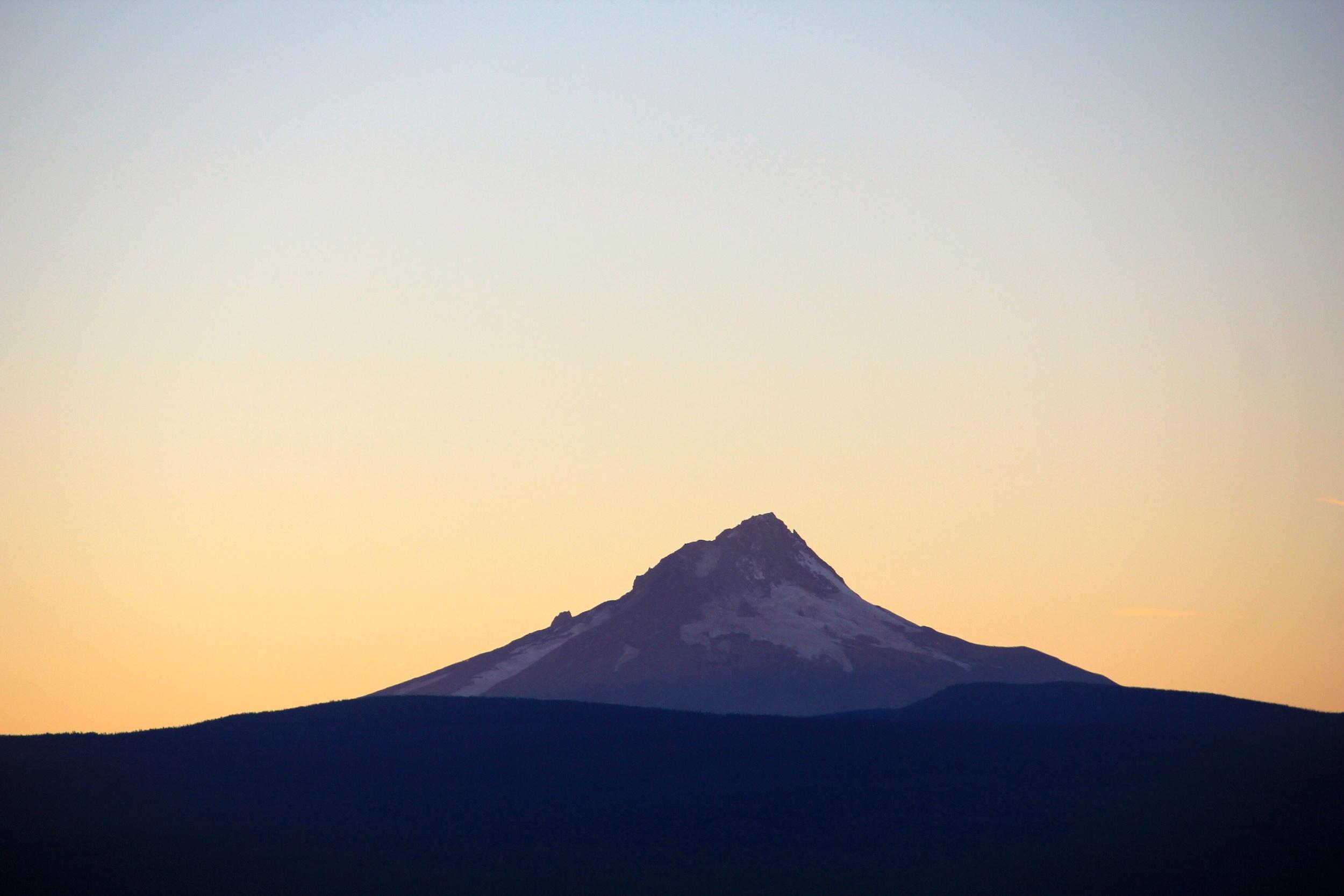 Mount Hood illuminated by the setting sun.