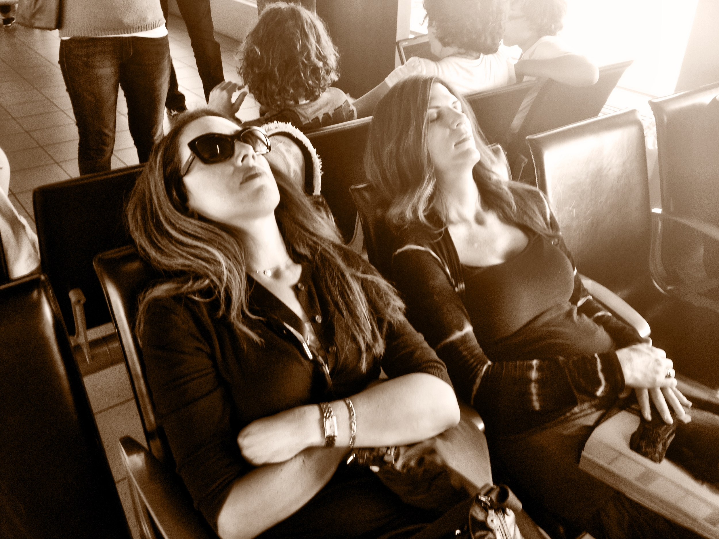 Gicela and Isabel catch a power nap in Amsterdam on our 2012 Tour