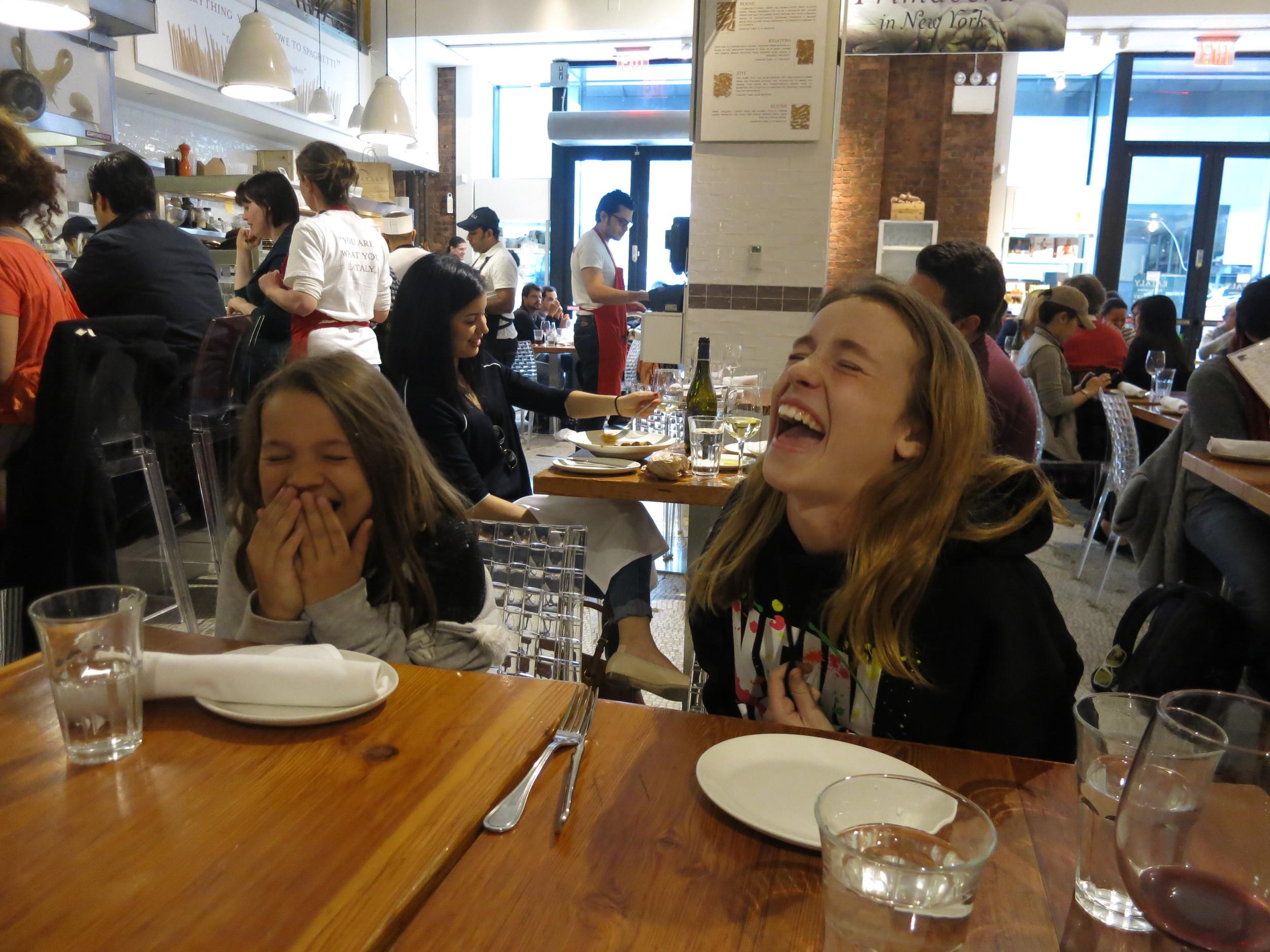 Sophia and Isabella Candelaria sharing a laugh at Eataly, NYC