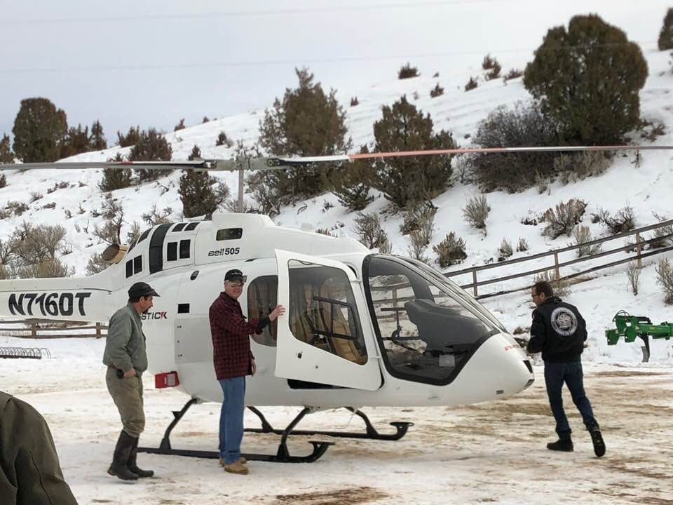 Getting ready to climb on board helicopter to tour Wyoming Project