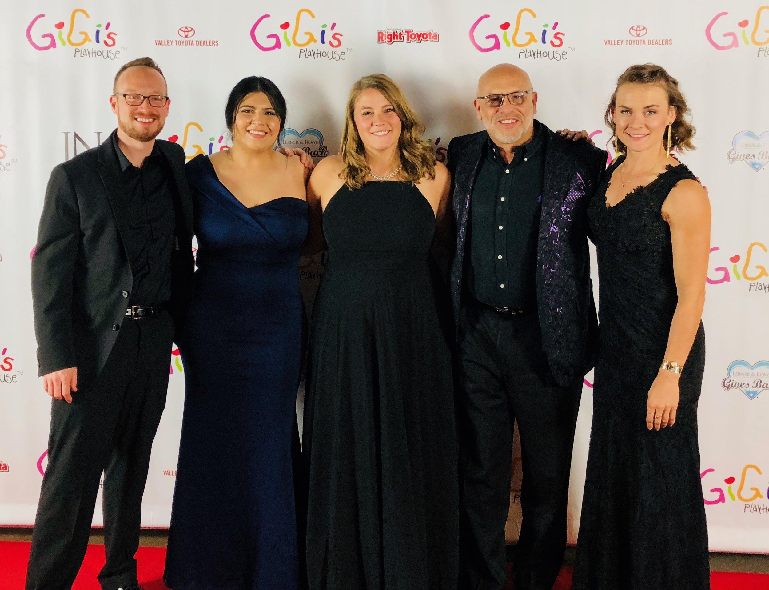 Damon Wake, Angeline Ponce, Nikka Bochniak, MC and Kim Schroeder at the Gigi's Gala