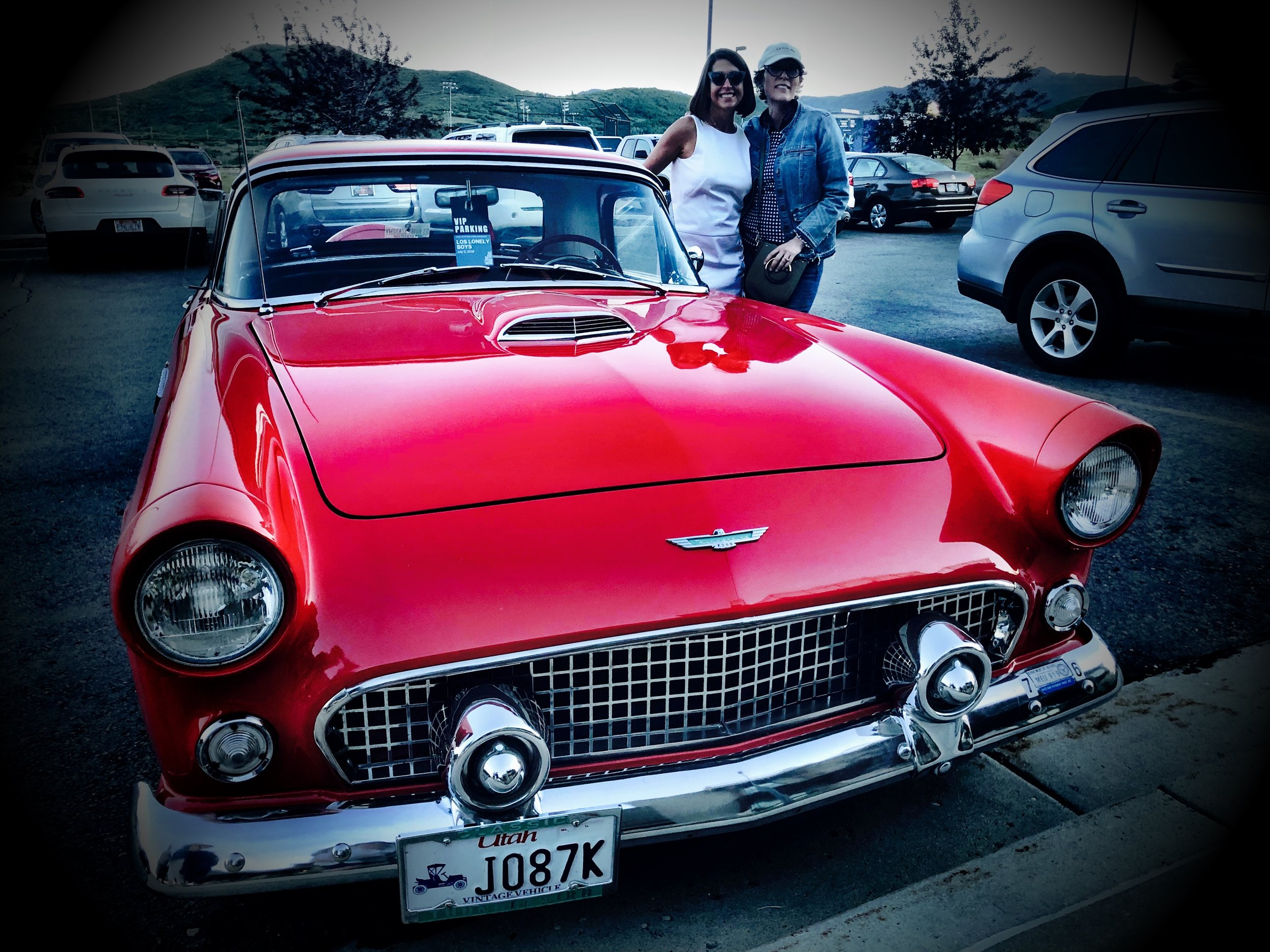 Isabel with her cousin Ember Conley and her classic Thunderbird in Park City at the Los Lonely Boys Concert July 2018