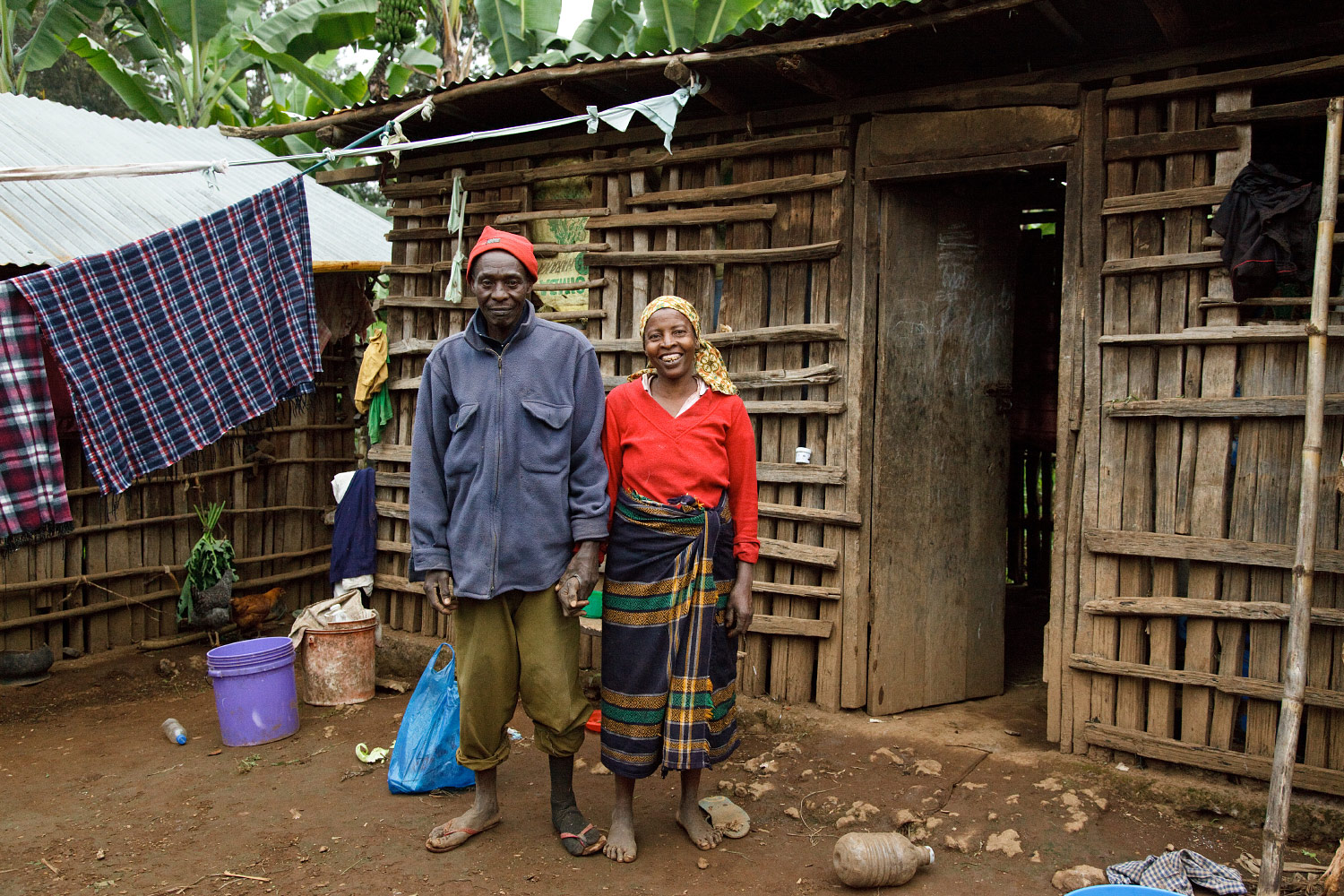 Husband and wife in front of their hut in Kibosho-Umbwe