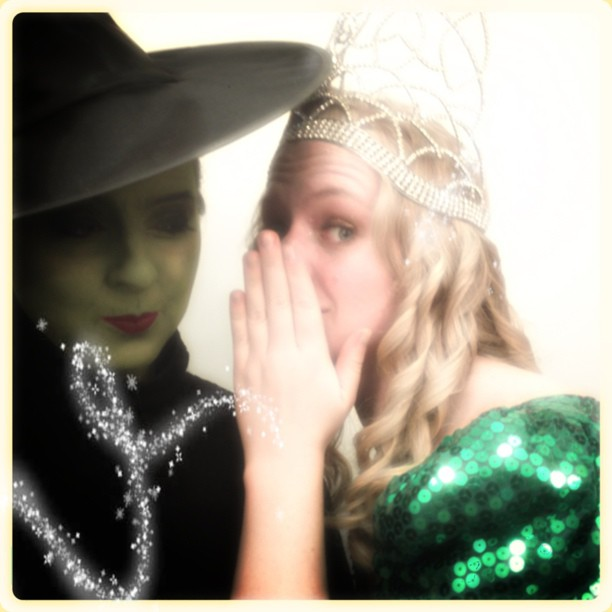 Darci is the woman in green in this photo. Not the woman in the green dress; the WOMAN IN GREEN.