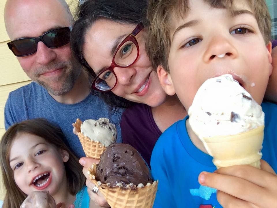 Four people cooler than the ice cream their holding. Also, messier than said ice cream.