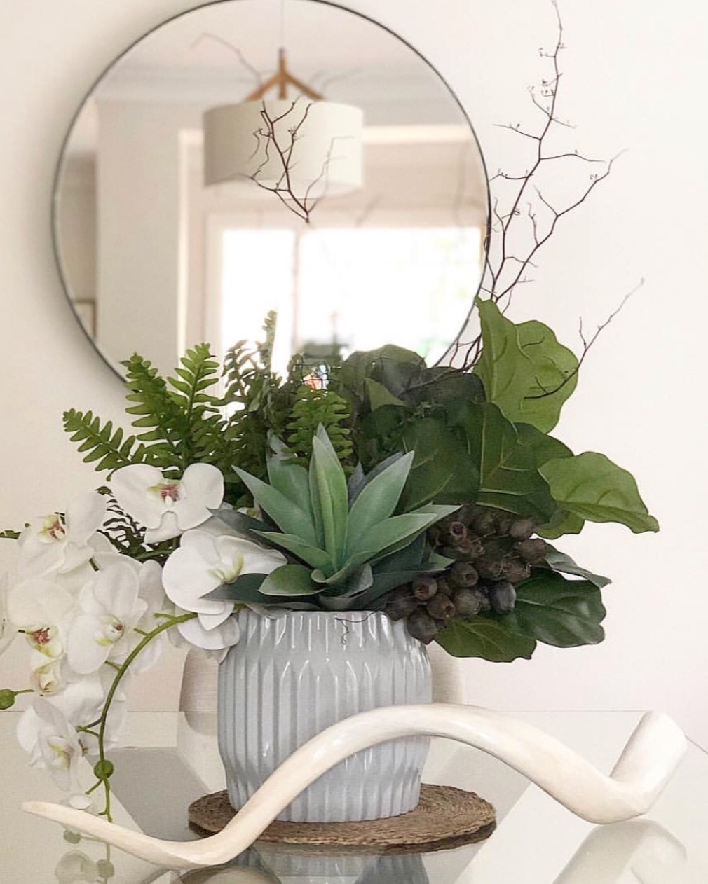 - Fresh FlowersAdding a fresh bunch of foliage/flowers brings life and warmth to any area of your home. Whether it be a simple arrangement or something more striking, any size helps to make you feel relaxed, feel welcomed and gives a sense of that 'home' feeling when buyers walk through your property. Placing a fresh arrangement in the entry way helps create an unforgettable first impression and simply displaying them in your living, dining and bedroom spaces will help add a fresh touch and a pop of colour, creating a welcoming, harmonious flow throughout.We love using long lasting foliage with lots of green that lasts the distance throughout our clients' sale campaign. This is not only pleasing to the eye but great on the budget as well.Image & Styling by Styleness