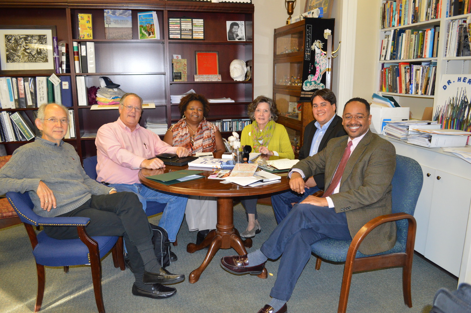 The Delta Center for Culture and Learning staff members Dr. Rolando Herts (right) and Lee Aylward (third from right) recently met with representatives from PathStone Puerto Rico Rural Innovation Fund and Mississippi Action for Community Education, Inc. of Greenville.