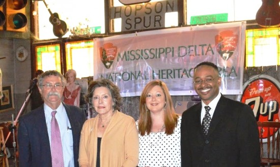 During the celebration of the Mississippi Delta National Heritage Area designation, Dr. Rolando Herts (far right), director of the Delta Center for Culture and Learning, is welcomed by (l to r) Dr. Luther Brown, former director; Lee Aylward, DCCL program associate for education and community outreach; and Heather Miller, DCCL program associate for projects. Photo by Roy Meeks.