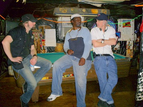 "PHOTO: (L to R) Award-winning Country musician and TV personality Jason McCoy, Terry ""Harmonica"" Bean, and TV producer Joel Stewart of CMT Canada, all at Po' Monkey's Lounge in Merigold, Mississippi, prior to shooting part of Jason McCoy Eats America."