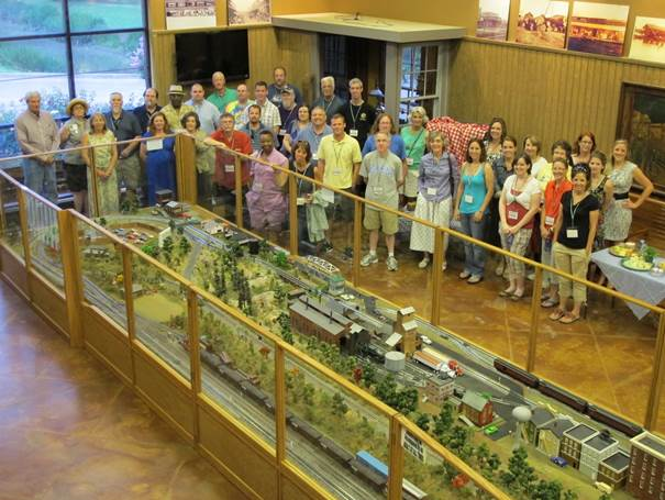 Photo: The opening reception of The Most Southern Place workshop, in the Martin and Sue King Railroad Museum. Photo by Rachel Anderson.