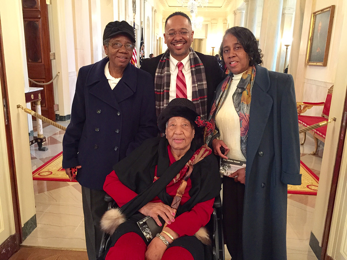 Annyce Campbell, seated, poses in the White House with her daughters Alma Campbell and Emily Harris, as well as Dr. Rolando Herts, director of the Delta Center for Culture and Learning.