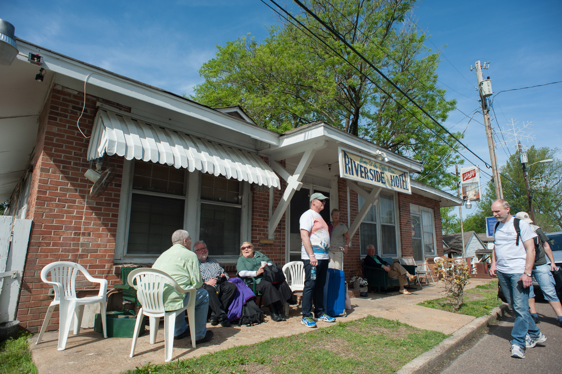 Members of the group relax in front of the Riverside Hotel, a former hospital for African Americans in Clarksdale.