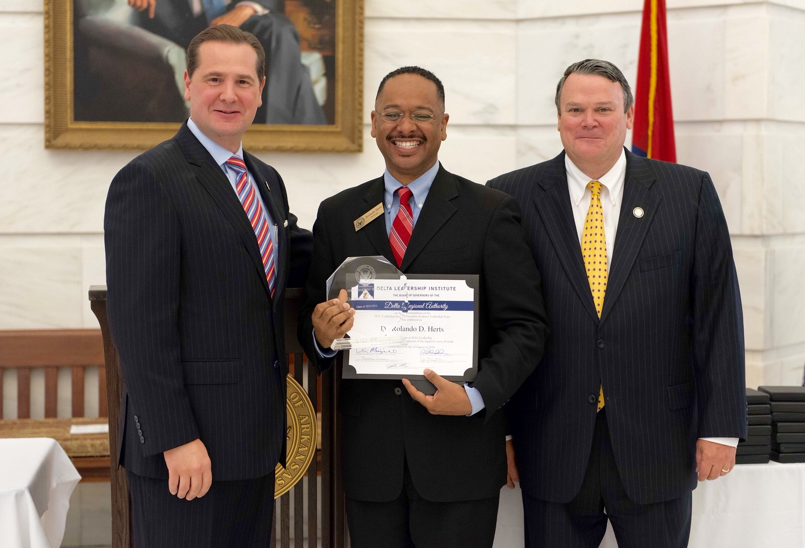 Dr. Rolando Herts, Director of The Delta Center at Delta State with DRA Federal Co-Chairman Chris Masingill (left) and Alternate Federal Co-Chairman Mike Marshall (right)