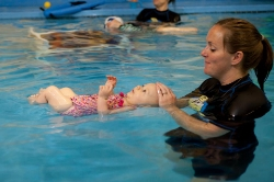 """Starfish: Water Safe - """"I am learning to be water safe!""""We as parents NEVER take our eyes off our children in the pool. Students that have accomplished STARFISH goals are able to float on their back independently. If this child were to fall or jump into any body of water he/she would be able to come up and float safely on his/her back. This is the infant survival stance. Parents need to be close by to assist this child to the edge of the pool as this level of training does not include rolling to tummy and swimming to the side of the pool."""